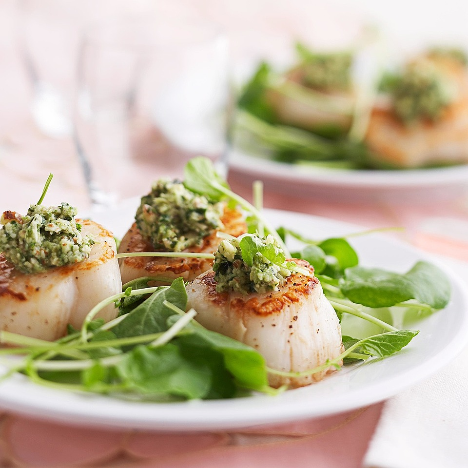 A refreshing mint, almond and Parmesan cheese topper is a tantalizing flavor partner for these plump, tender sea scallops. Source: Diabetic Living Magazine