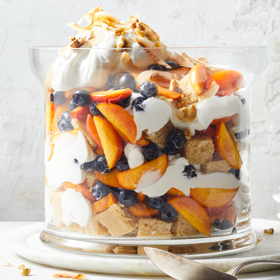 This stunning fruit-filled trifle is a perfect make-ahead dessert for summer barbecues and dinner parties. Resist the urge to dig in until the trifle has chilled for at least a few hours--that time lets the flavors mingle and allows the cake to absorb the rum and fruit juices.