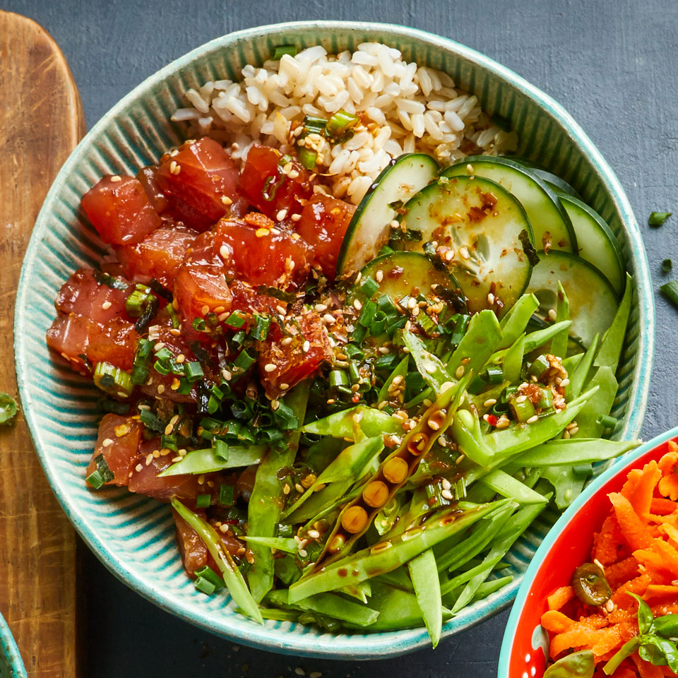 "Poke (pronounced poke-ay), a Hawaiian word meaning ""to chop"" or ""to cut,"" refers to a traditional Hawaiian salad of diced raw fish in a simple, soy-based sauce with punchy seasonings like toasted sesame and chopped scallion greens. Serve with seasoned brown rice for a healthy, satisfying meal packed with veggies, protein and fiber. Source: EatingWell Magazine, July/August 2018"