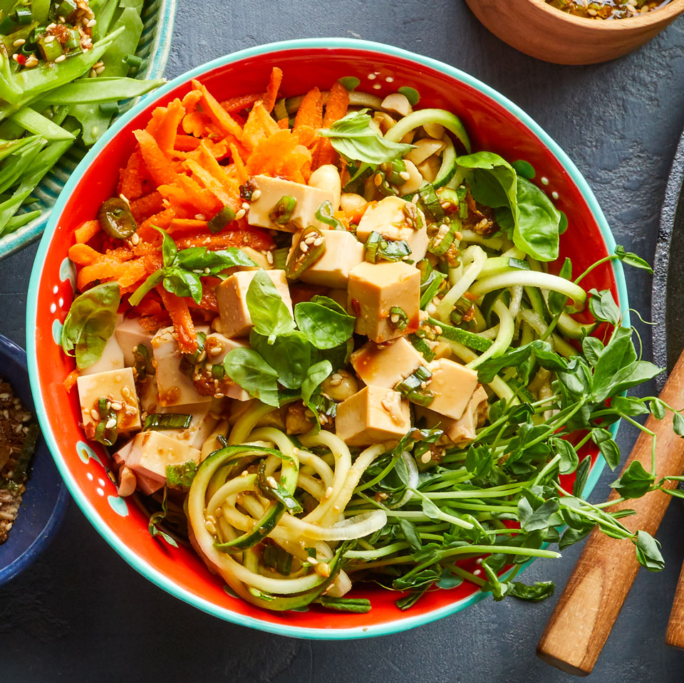 This fast vegan version of poke (the traditional Hawaiian salad of diced raw fish tossed in a soy-sesame sauce) swaps in extra-firm tofu for fish while loading your bowl with vegetables and crunchy toppers like pea shoots and peanuts. Serve over brown rice instead of the zucchini noodles to add a hearty boost of fiber.