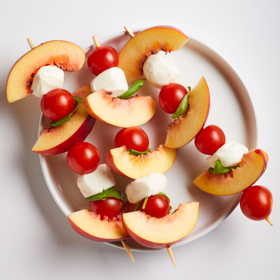 Fresh peaches liven up a classic caprese salad in this super-fast snack. Make this recipe for one or make a bunch for a party appetizer. Source: EatingWell Magazine, July/August 2018