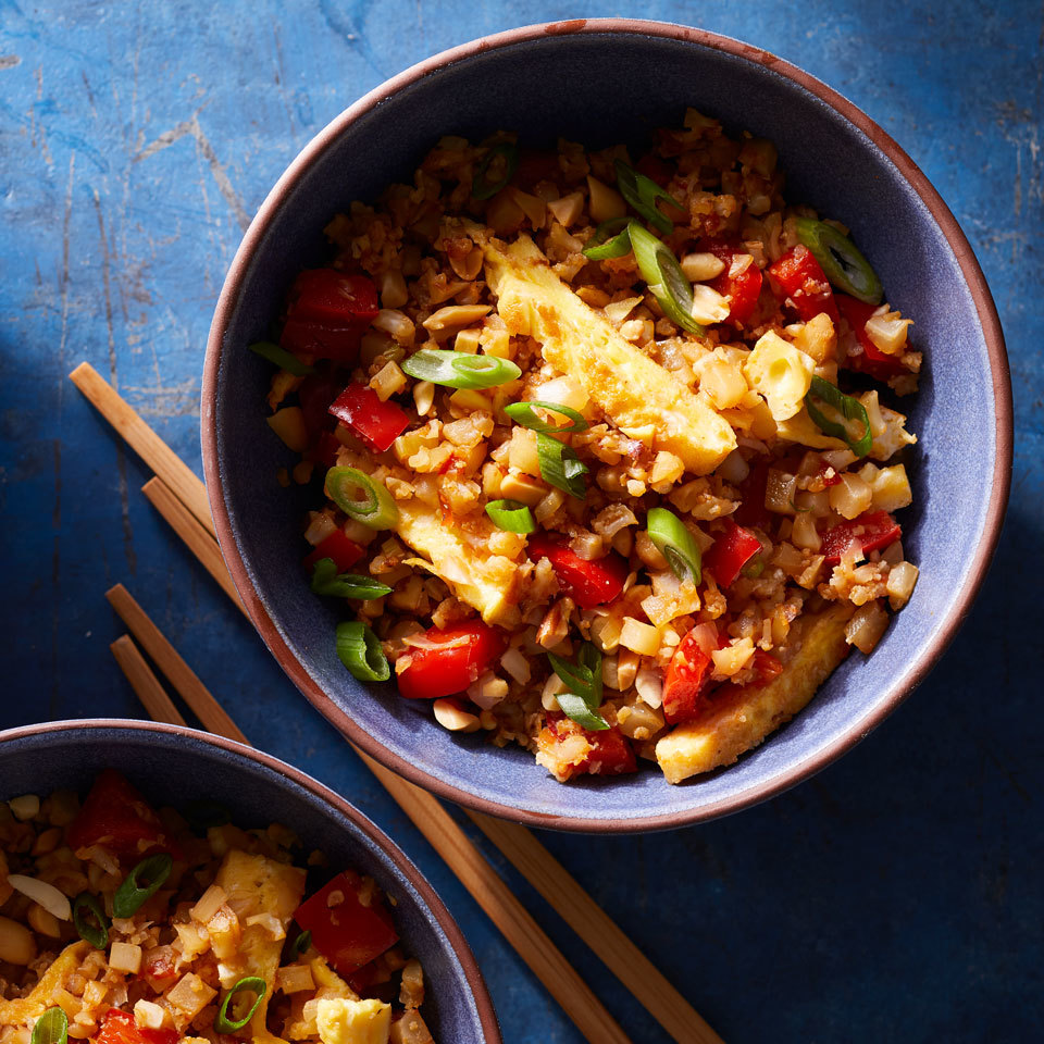 This vegetarian faux fried rice uses riced cauliflower in place of white or brown rice to pack in extra veggies and cut down on carbs. Chile-garlic sauce pumps up the heat, and fresh ginger adds a bright, warm bite. If you don't like the heat of the chile-garlic sauce, leave it out and add a bit more tamari or soy sauce for a rich, fermented tang. Source: EatingWell.com, June 2018