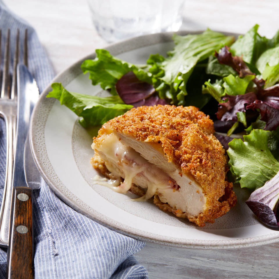 This classic chicken recipe for crispy chicken breasts filled with ham and melty cheese is baked, instead of fried, for a lightened-up, delicious dinner.