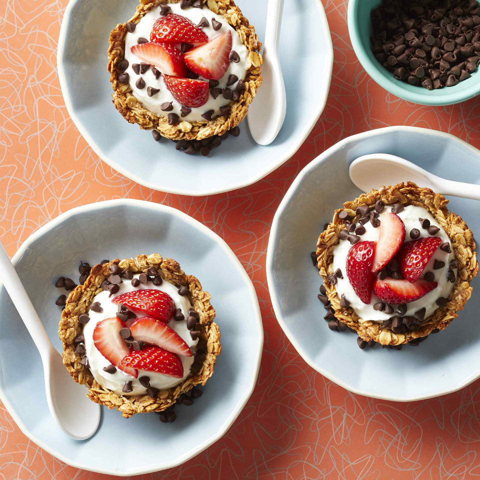 Kids will love this healthy breakfast riff on a classic sundae. We replace the ice cream with good-for-you Greek yogurt topped with fresh berries and a few chocolate chips; it's all served in an edible granola bowl for extra fun.
