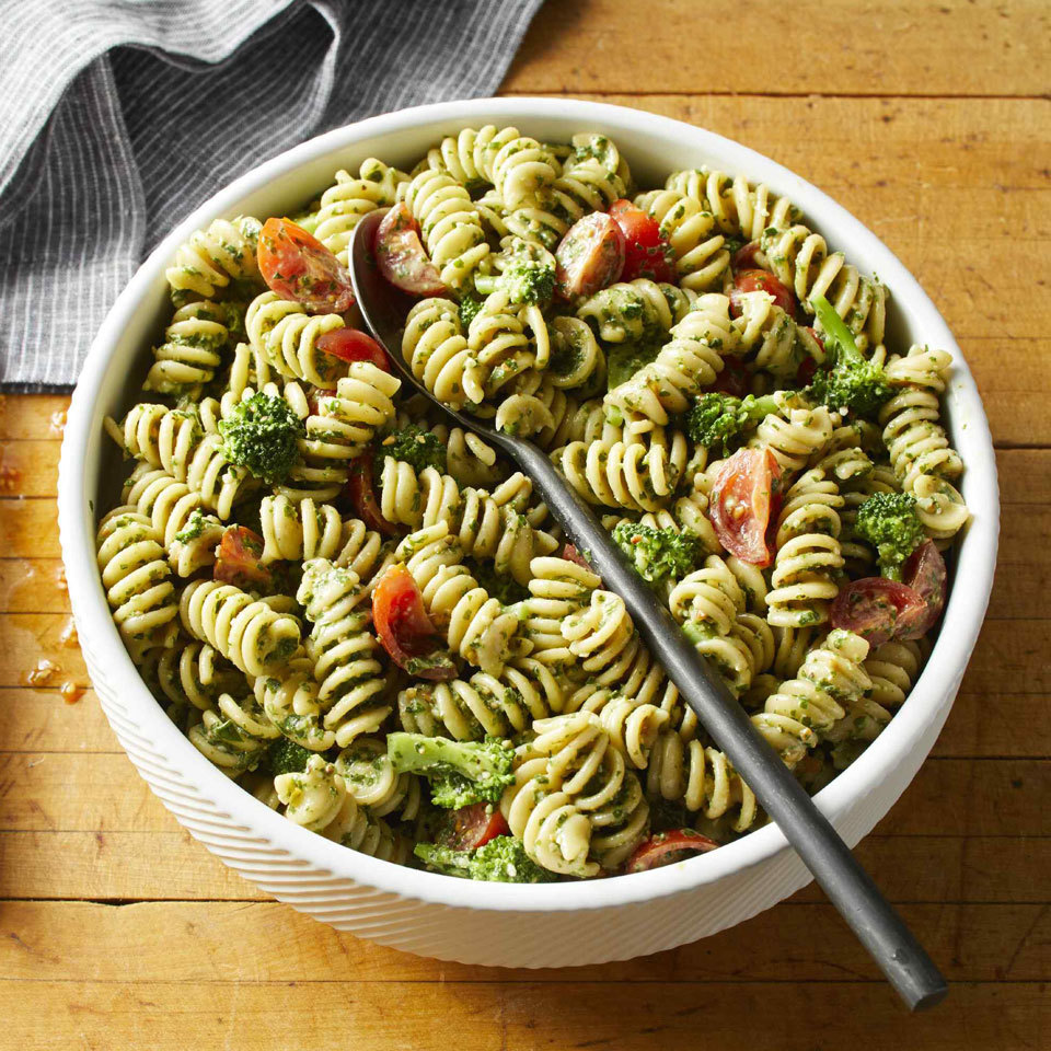 A creamy pesto sauce turns this simple pasta salad into a delightful dinner. Adding broccoli to the pasta cooking water just before the pasta is done is a convenient way to briefly cook it so that it turns a vivid shade of green and softens slightly. Source: EatingWell.com, June 2018
