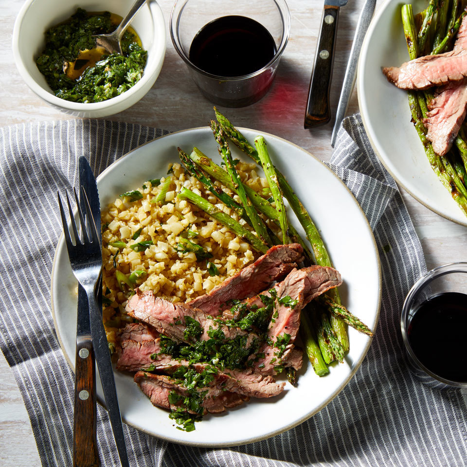 This elegant steak dinner for two features asparagus drizzled with a bright chimichurri sauce. A bed of cauliflower rice sops all the extra juices, but you could stir the herby sauce into the rice for extra flavor. This dish is easy enough for a weeknight dinner but delicious enough for date night or a dinner party. Source: EatingWell.com, July 2018