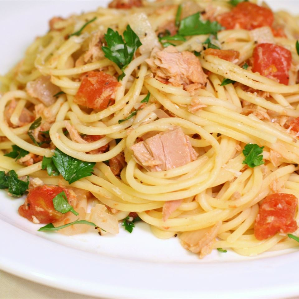 """Here's a feast from the pantry! Featuring canned tuna, tomatoes, spaghetti, and red pepper flakes. """"A wonderful tasting dish that is very easy to make,"""" says evilynn. """"I added black olives and used tomatoes that I had canned from our garden over the summer."""""""
