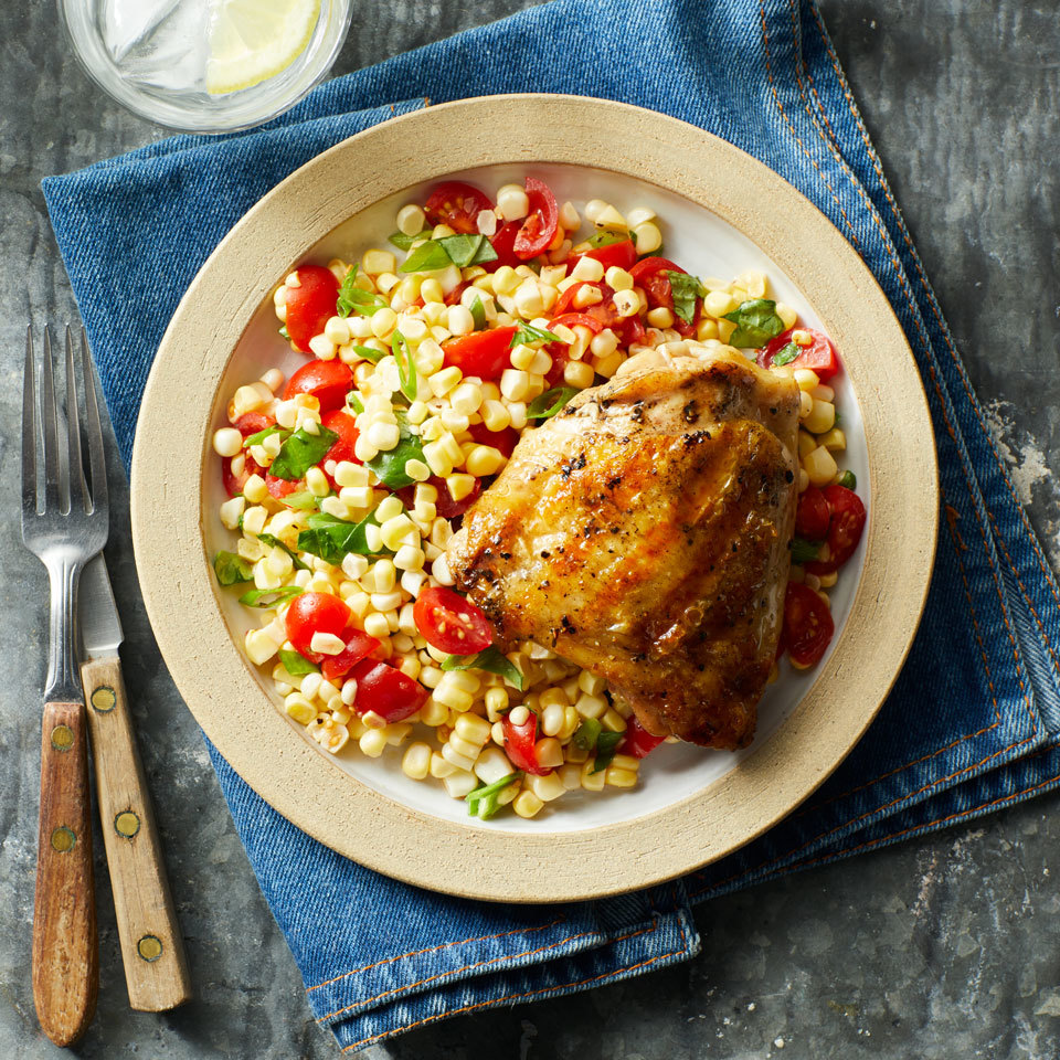 Chicken thighs are easy on the budget and great for grilling because they stay moist in the heat. Here, they are paired with a fresh corn and tomato salad for a simple summer dinner. When grilling skin-on chicken thighs, watch for flare-ups. Move the chicken away from the flames and reduce heat, if necessary, to keep it from charring. Source: EatingWell.com, July 2018