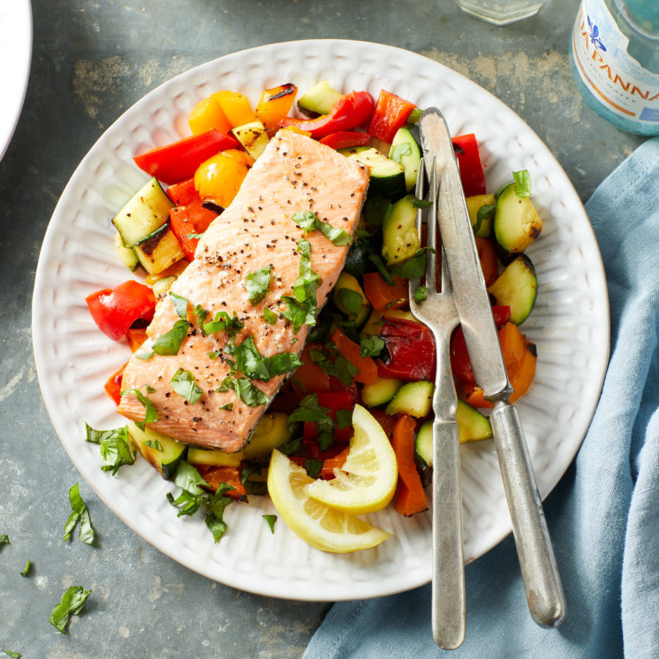 Grilled salmon and veggies make for a colorful and balanced seafood dinner that's ready in just minutes. The grill turns the salmon flaky and moist while tenderizing the crispy pepper and onion pieces. Round out the meal with brown rice or quinoa. Source: EatingWell.com, July 2018