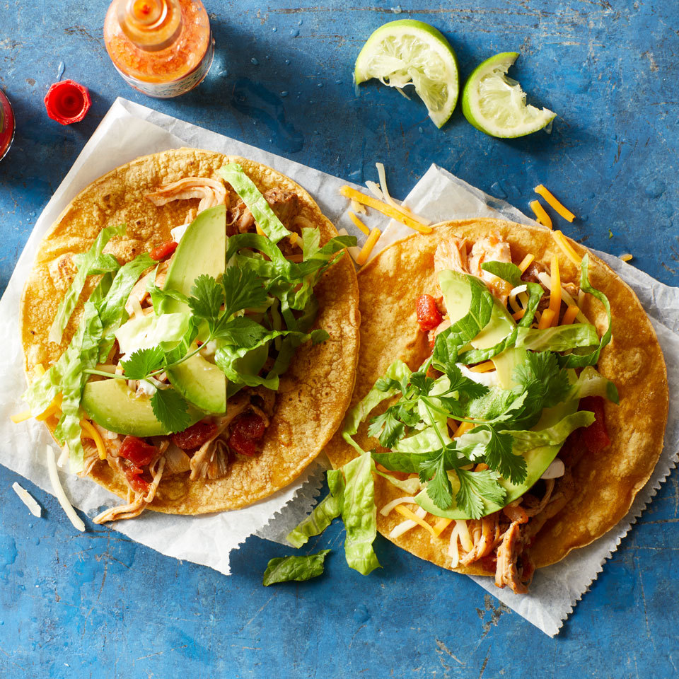 Shredded chicken thighs, infused with the flavors of garlic, ancho chile powder and tomatoes, make a delicious taco filling in just eight minutes thanks to your pressure cooker or Instant Pot. Don't have this spice? Any mild chile powder will work well. Source: EatingWell.com, July 2018