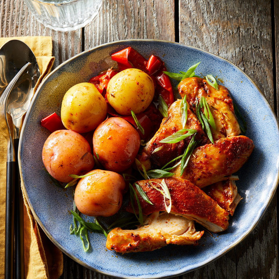 Simple ingredients like chicken thighs, potatoes and bell pepper turn fall-off-the-bone tender in the pressure cooker or Instant Pot in just minutes. A splash of vinegar and a sprinkle of scallion just before serving add zing to this classic family dinner. Source: EatingWell.com, July 2018