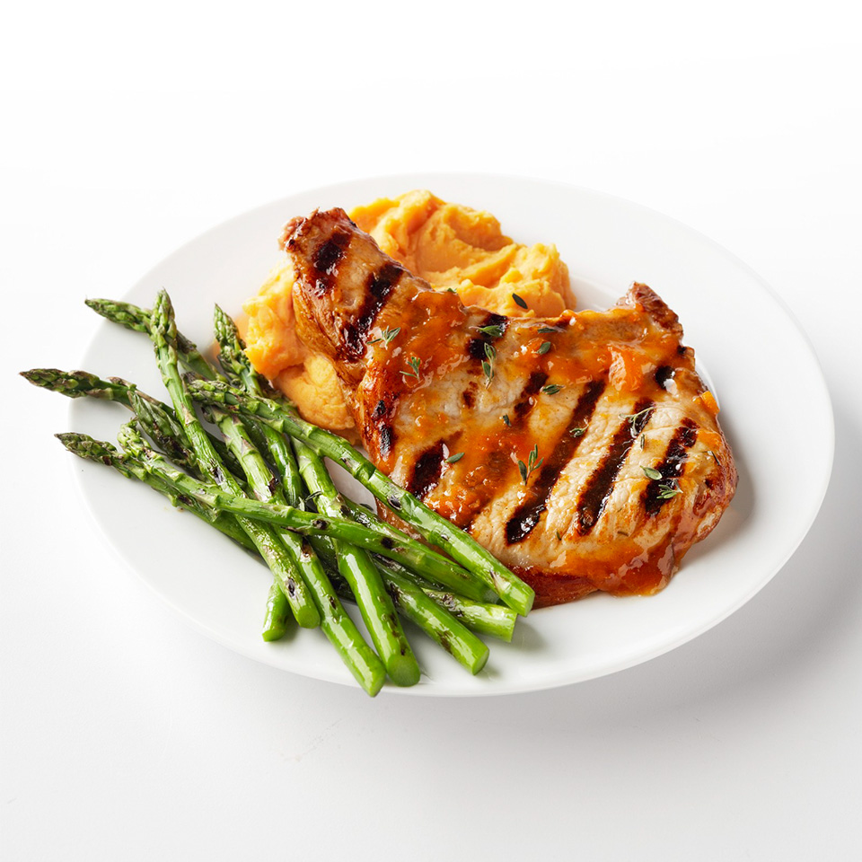 This quick-and-easy pork chop recipe can be on the table in just 15 minutes. The chops are topped with an apricot-cinnamon glaze, grilled and then finished off with a sprinkling of fresh thyme. Source: Diabetic Living Magazine