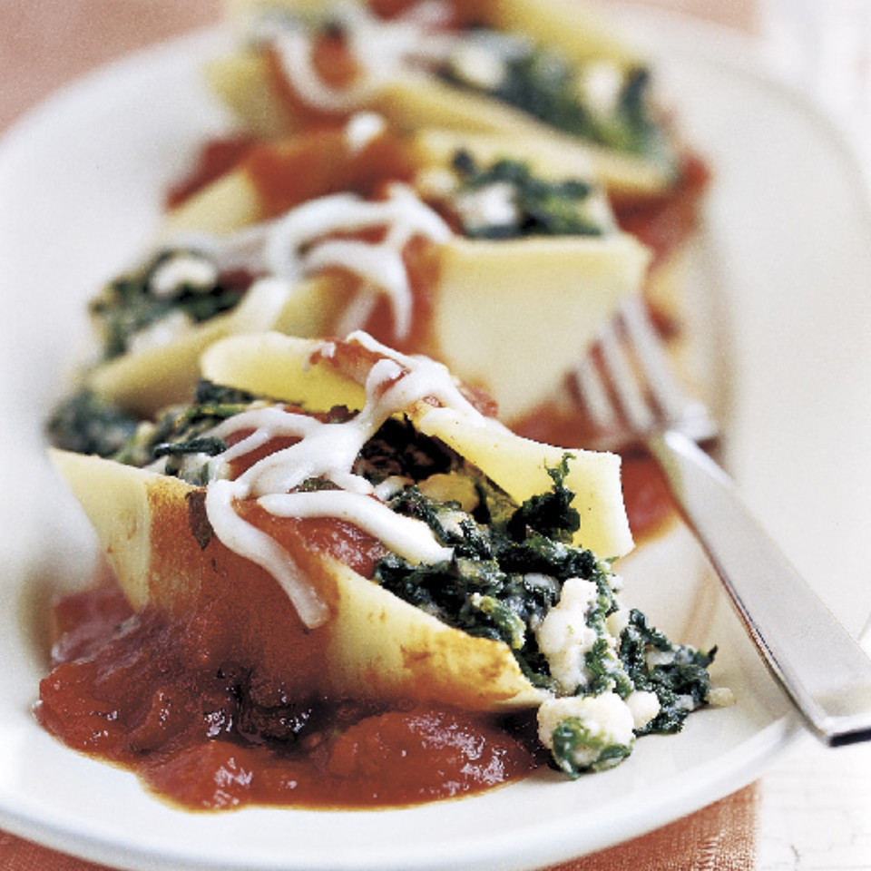 Jumbo pasta shells are filled with a heavenly mixture of feta, ricotta and spinach in this dinner recipe. Using mint adds a refreshing flavor to the sauce and eliminates the need for salt.