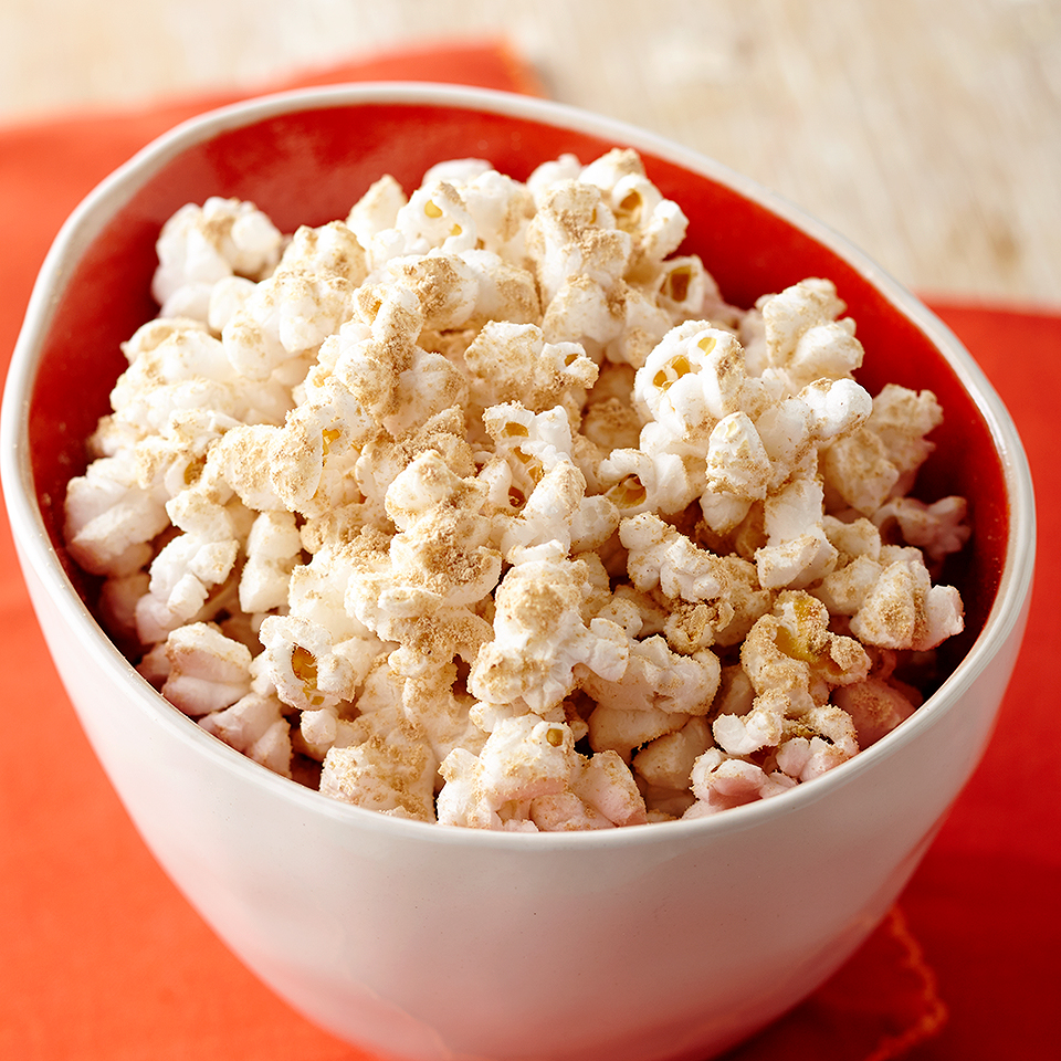 This Chocolate Peanut Butter Popcorn is quick, satisfying, and kid friendly. Kids can help prepare by measuring the powdered peanut butter and adding it to popcorn.