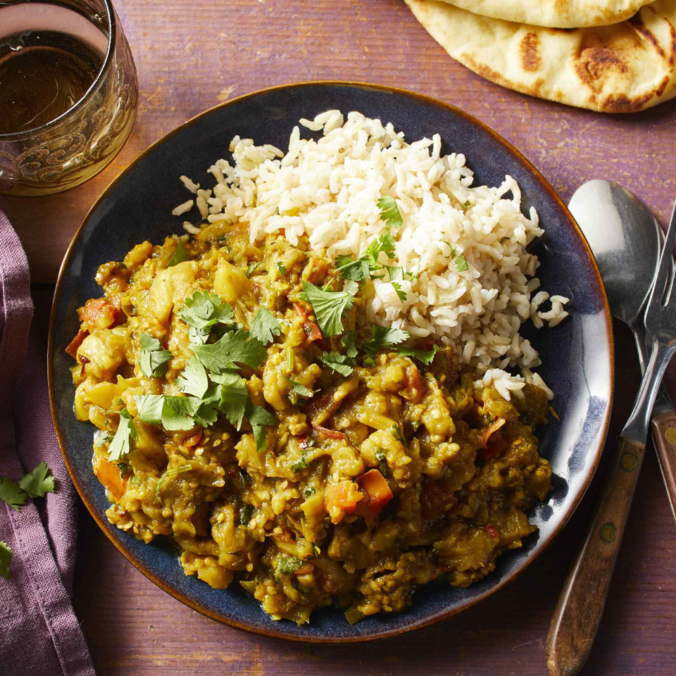 This spicy eggplant dish, popular in India and Pakistan, can be eaten hot or at room temperature. Serve with brown basmati rice and naan. Save leftovers if you can; the dish tastes better on day two when all the flavors have had a chance to meld.Source: EatingWell.com, July 2018