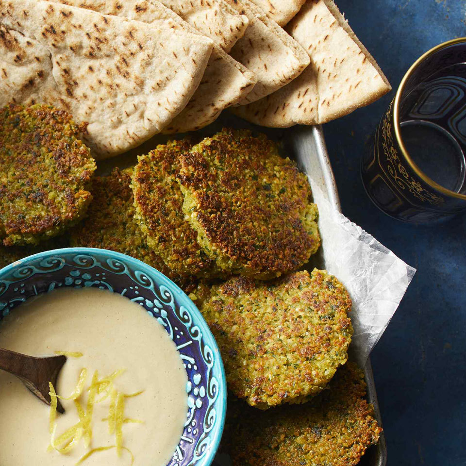 Tuck these tasty chickpea patties into whole-wheat pitas and top with tahini sauce (see associated recipe, below). Be sure to soak the chickpeas overnight for the creamiest mixture. The quick-soak method won't work for these pan-fried falafel patties.