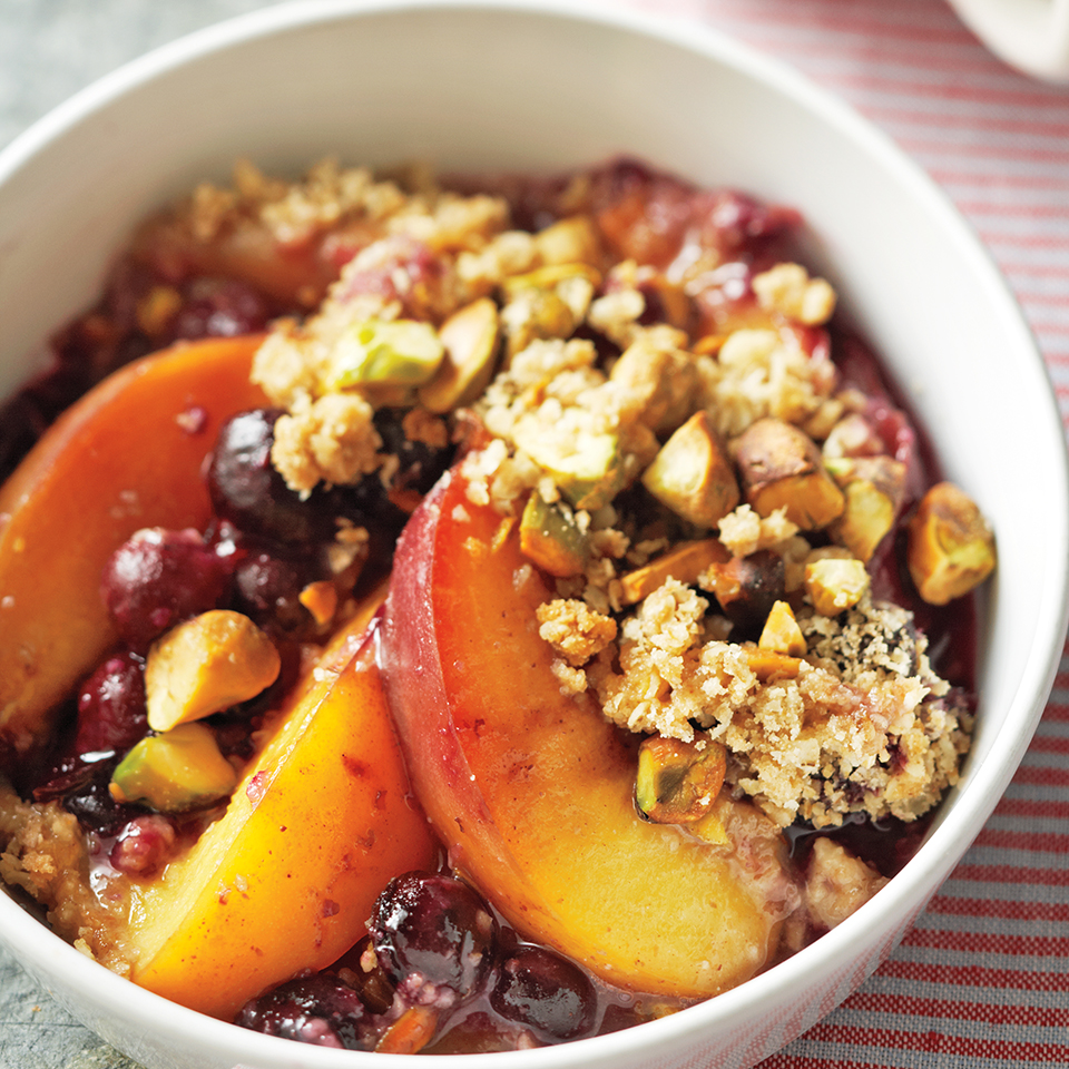 In this tasty, easy-to-prepare dessert, nectarines and blueberries are sweetened with brown sugar and topped with a crunchy pistachio-oat topping. Source: Diabetic Living Magazine