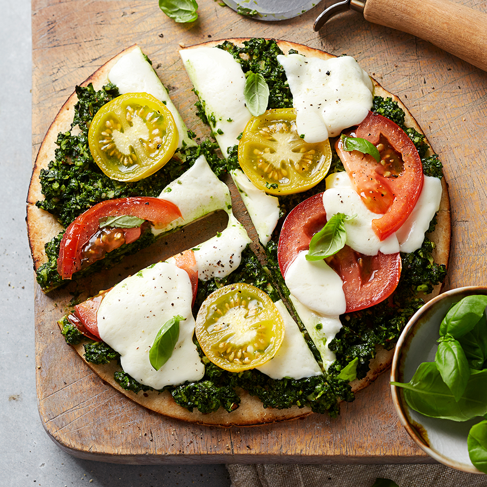 This flatbread pizza serves two and is ready in under 30 minutes. Its topped with a homemade basil and almond pesto, sliced tomatoes and fresh mozzarella.Source: Diabetic Living Magazine
