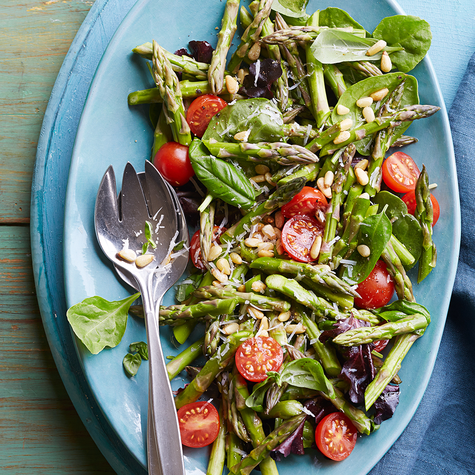 Topped with Parmesan cheese and pine nuts, this tasty green salad is perfect for any barbeque or picnic.