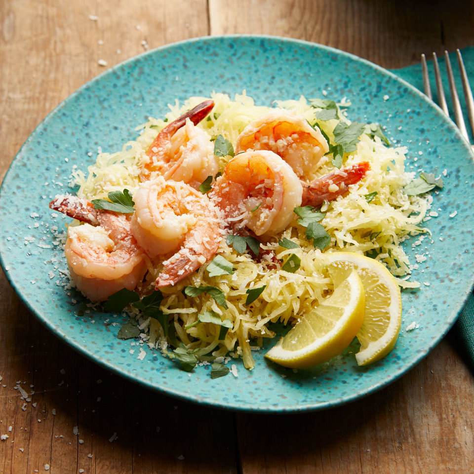 "Give buttery shrimp scampi a healthy update with delicately sweet spaghetti squash. The parsley-flecked squash ""noodles"" slash calories, add fiber and leave this classic dish still plenty decadent. Source: EatingWell.com, July 2018"