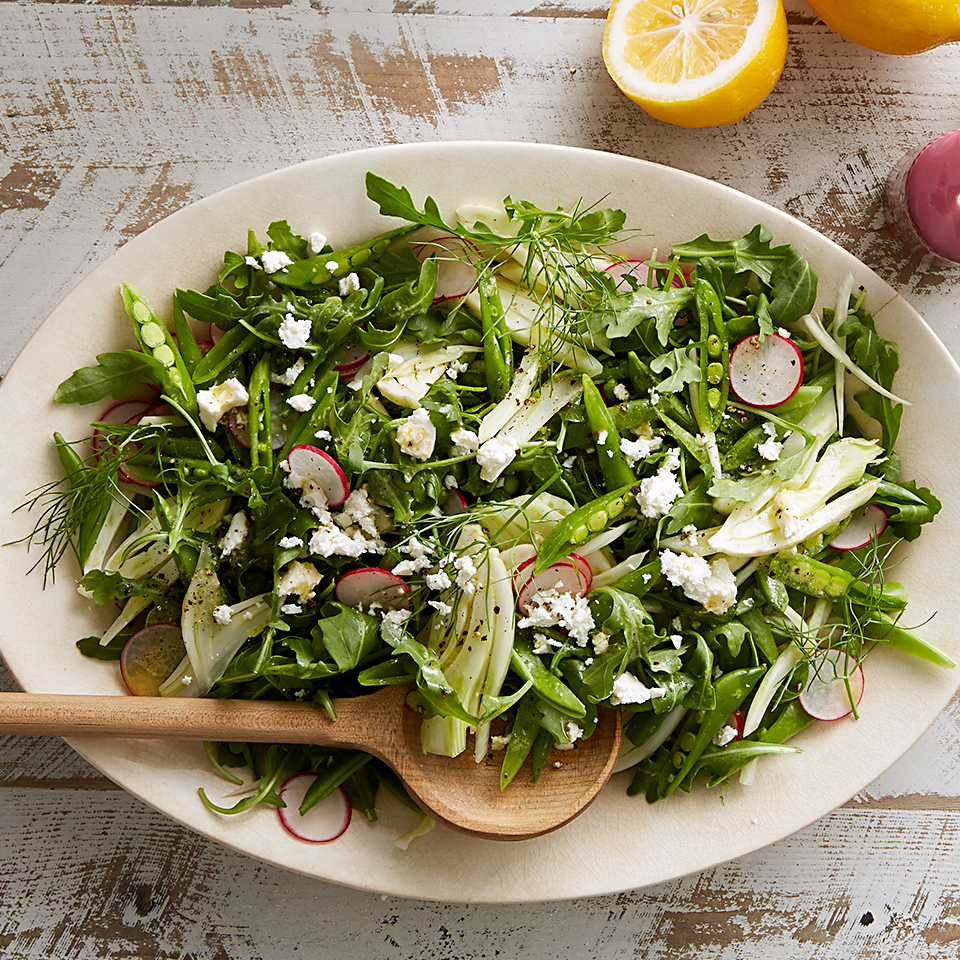 Fresh greens, lemony vinaigrette, briny feta, and crisp radishes and pea pods all come together in this side salad that you'll want at every meal. We love Meyer lemons in this salad, but any variety will do.
