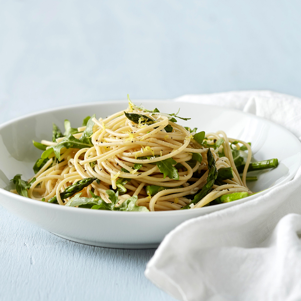 """Cacio e pepe"" means ""cheese and pepper"" in Italian. This spaghetti dish, with fresh asparagus and baby arugula, is flavored with ""cacio e pepe"" and a little lemon zest. It's simple to prepare and on the table in just 25 minutes. Source: Diabetic Living Magazine"