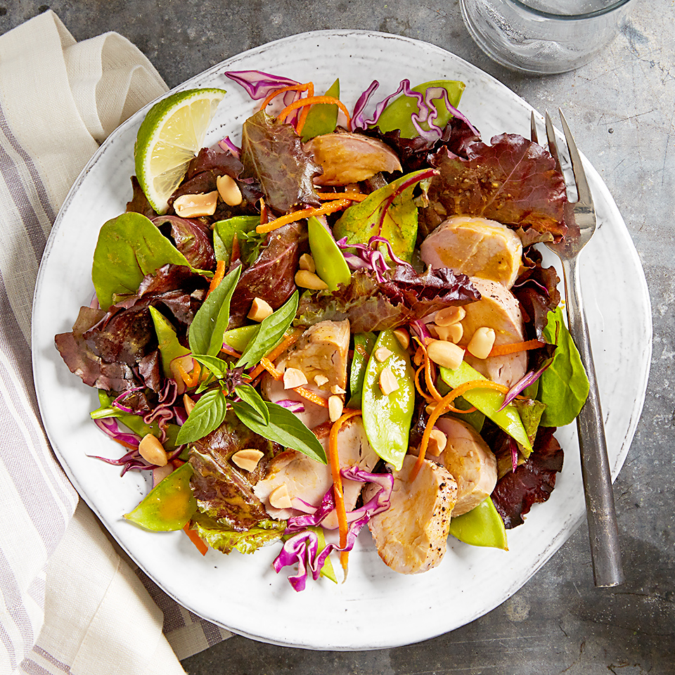 Pork tenderloin slices provide the protein in this quick and colorful Thai-inspired dinner salad. It's full of crunchy romaine lettuce, carrots, cabbage and pea pods and is flavored with a delicious peanut satay sauce and fresh basil. Source: Diabetic Living Magazine
