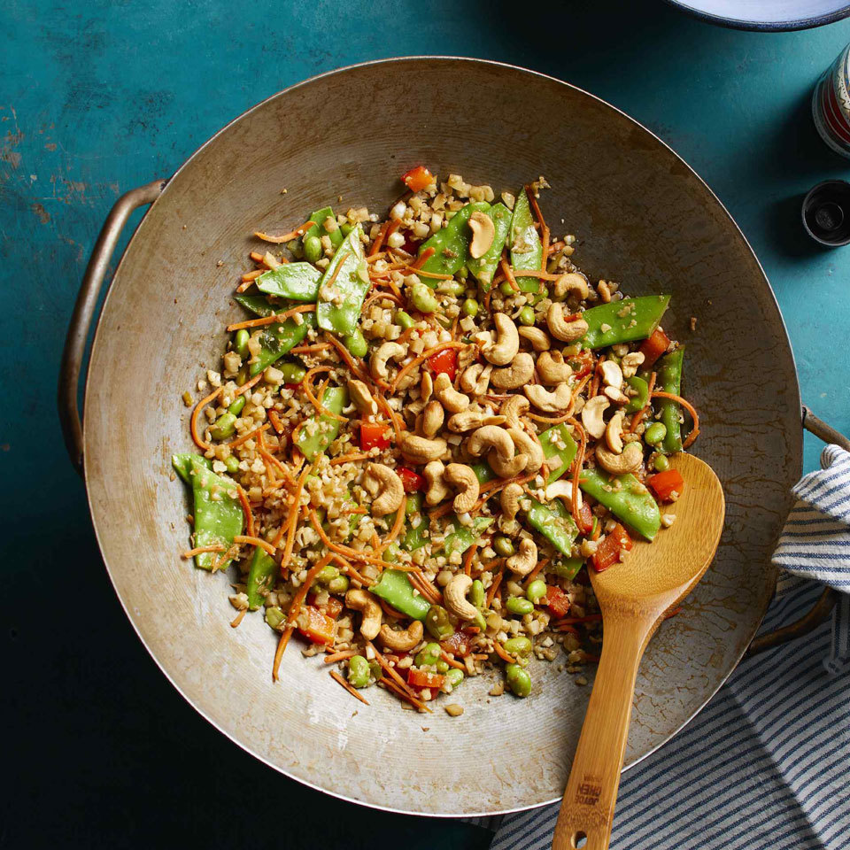 Substituting riced cauliflower for rice trims calories and carbs in this veggie-packed dish. Use the vibrant flavors of traditional fried rice--ginger, scallions and tamari--to create a low-carb fried rice version of the classic take-out meal. Source: EatingWell.com, July 2018