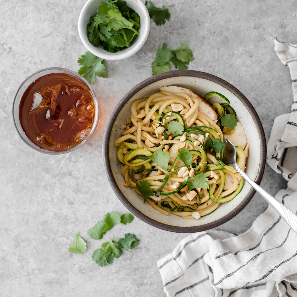 Mix udon and zucchini noodles for a lower-carb noodle bowl that's full of flavor thanks to the finger-licking-good peanut sauce. Using leftover chicken will save you even more time on this quick dinner recipe--you can whip it up in about 10 minutes. Source: EatingWell.com, July 2018