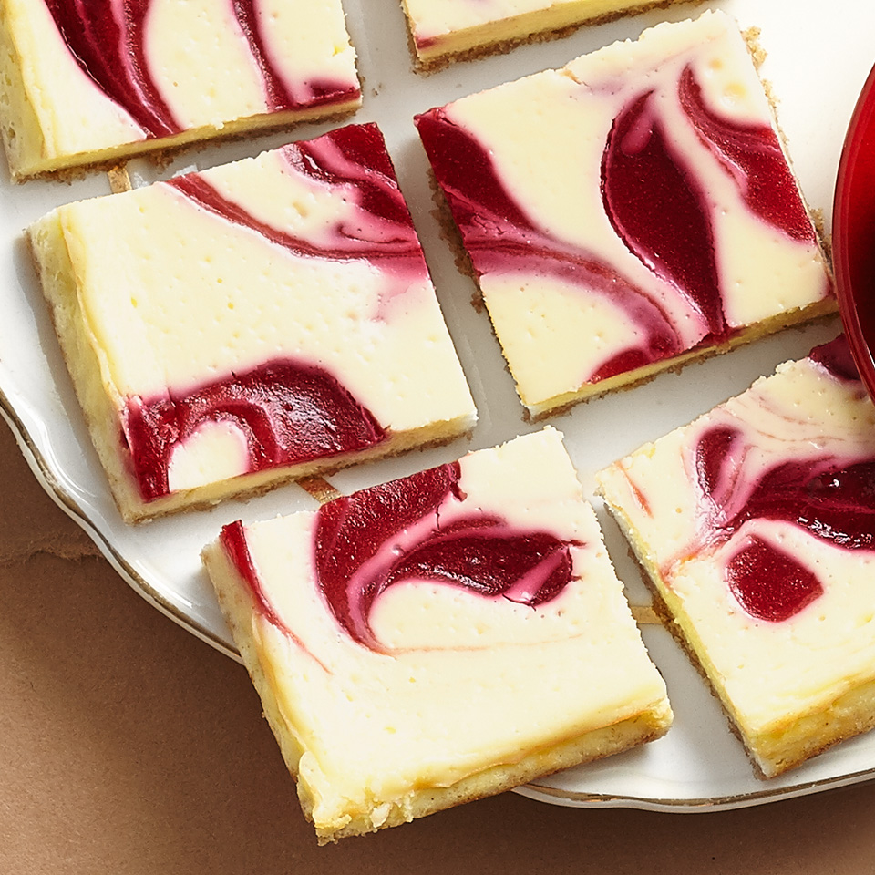 A great dessert option for your next holiday party, these sweet cheesecake bars have an oat crust and a cranberry-orange sauce that's swirled on top and baked right in.