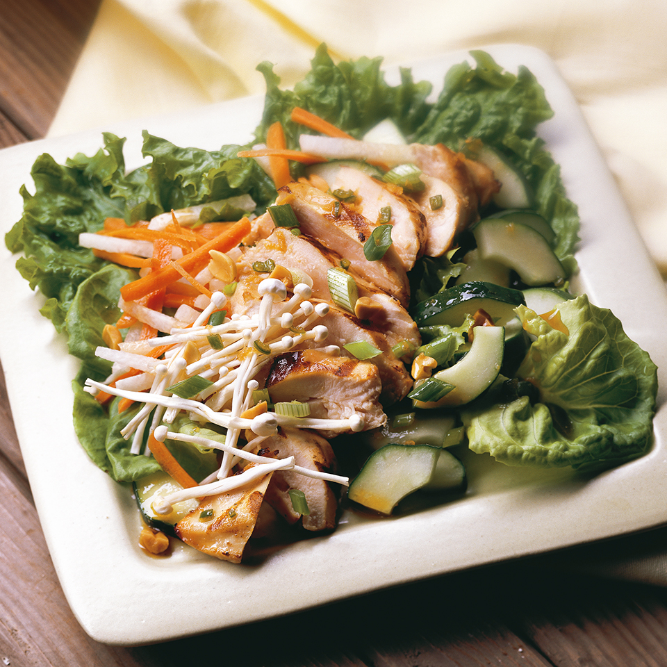 Jicama, a crisp root vegetable, stars in this grilled chicken salad with carrot, cucumbers, and enoki mushrooms. A light sprinkling of peanuts adds crunch and flavor. Source: Diabetic Living Magazine