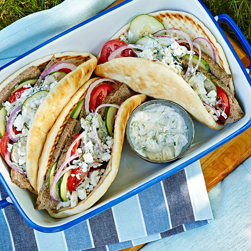 A gyro is a Greek sandwich made of thin slices of roasted meat, served on pita bread with a cucumber-yogurt sauce. In this recipe, lean ground beef is seasoned with oregano and marjoram, pressed into a loaf pan, baked and thinly sliced to fill the pita.