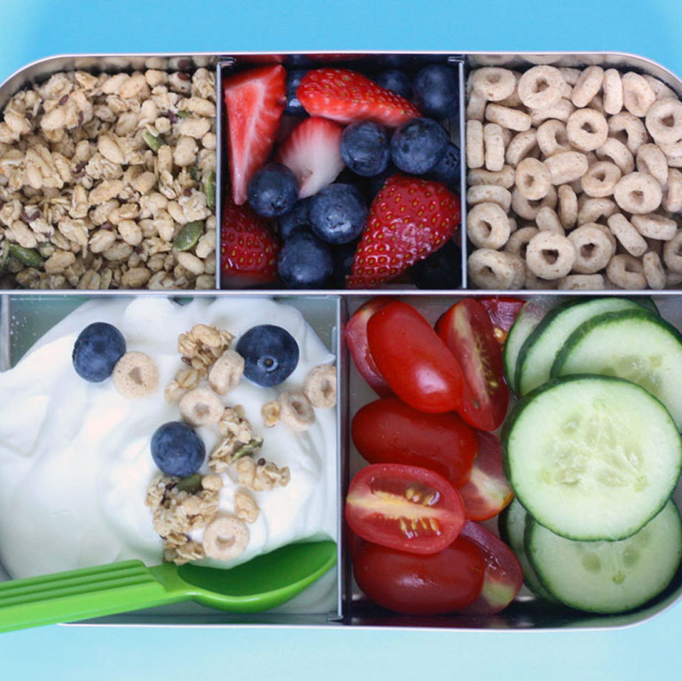 Greek yogurt provides the filling protein base for this colorful lunch box, but the remaining ingredients are very flexible to accommodate your child's tastes. You can replace the cereal or granola with dried fruit, and swap steamed vegetables for the cherry tomatoes and cucumber. Source: Eatingwell.com, August 2018