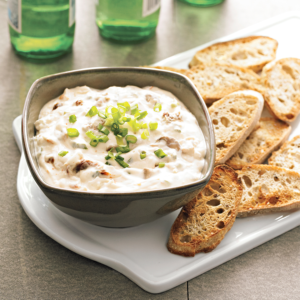 Serve this cheese, tomato, and mushroom dip warm with freshly-toasted French bread slices for a wonderful party appetizer. The slow-cooker recipe makes enough for a crowd.
