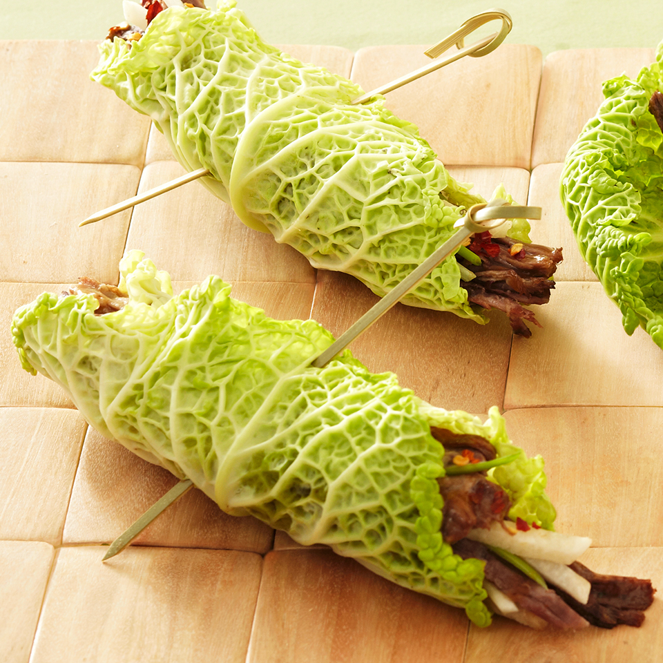 Tender beef is slowly simmered with Asian-inspired flavorings and served wrapped in fresh cabbage or lettuce leaves for a lighter touch.Source: Diabetic Living Magazine