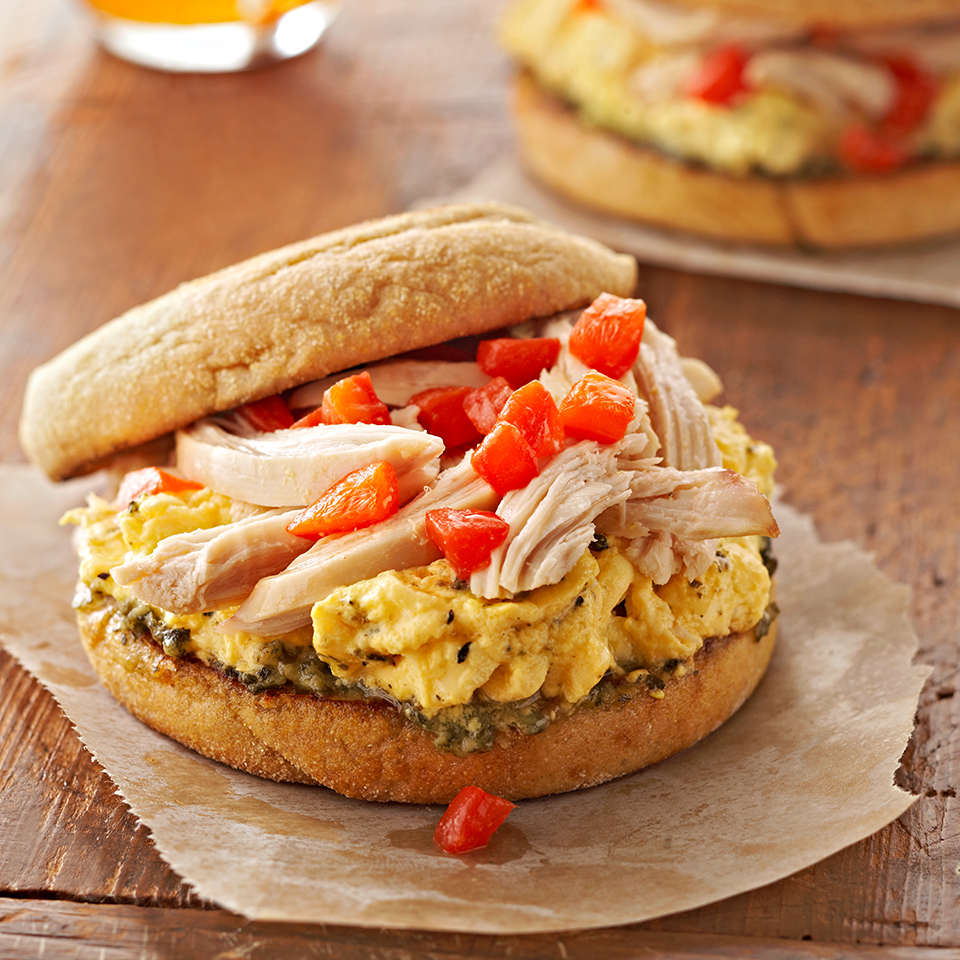 This breakfast sandwich will satisfy your hunger for hours. It features Italian-seasoned scrambled eggs, shredded chicken breast and strips of roasted sweet peppers atop a pesto-smeared toasted whole-grain English muffin.