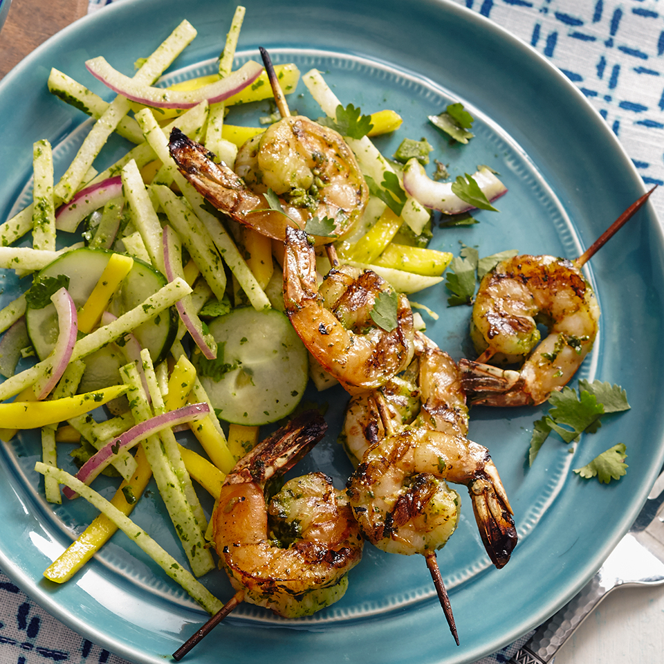 Instead of serving boring burgers and humdrum hot dogs at your next barbecue, try these zesty shrimp skewers! Your guests will be transported to the islands with each bite of spicy shrimp and citrus-dressed mango-jicama salad.
