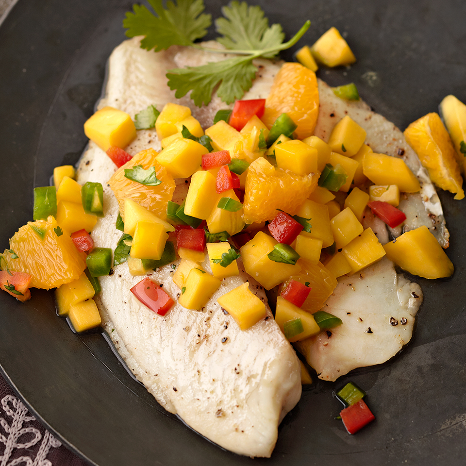 Mild tilapia filets are marinated in an orange-cayenne pepper mixture in this sweet and spicy fish recipe. And because spice is nice--chopped jalapeños are added to the fruit salsa to kick it up the heat just a bit more. Serve over brown rice to round out the meal. Source: Diabetic Living Magazine