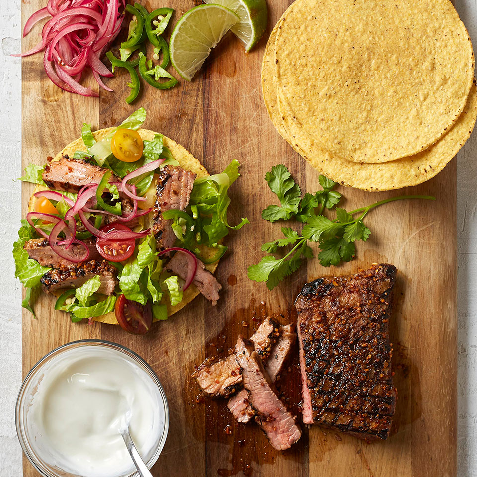 Quick-pickled onions and a simple yogurt-lime cream sauce lend complex flavors to these crispy steak tostadas. Source: Diabetic Living Magazine, Fall 2018