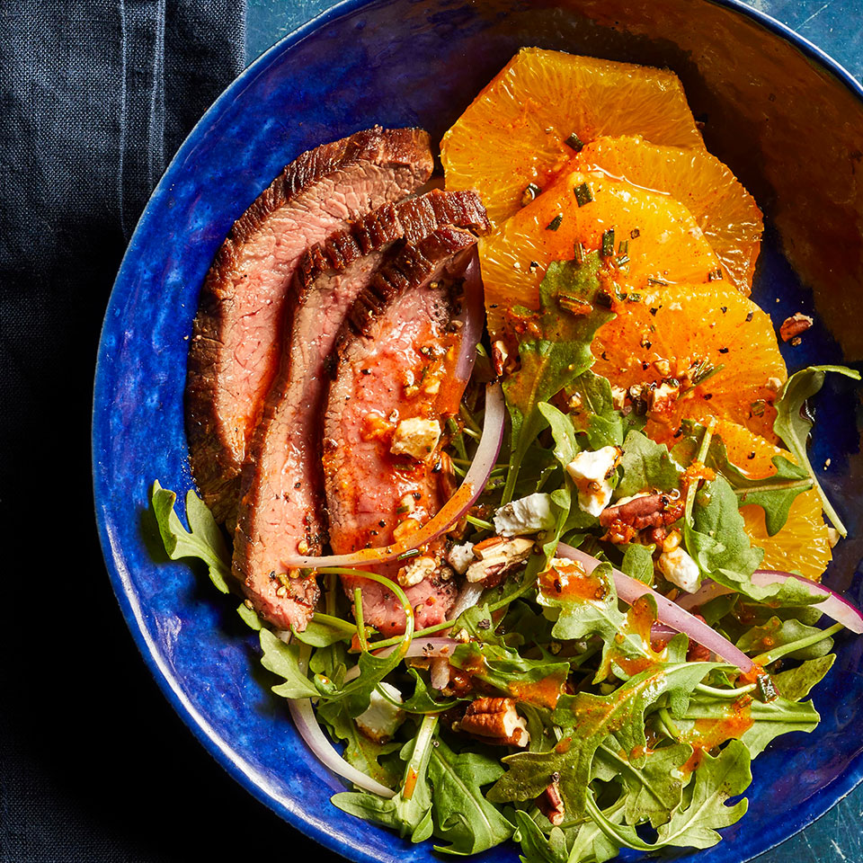This elegant salad pairs a simple seared flank steak with a bright citrus dressing and creamy goat cheese.