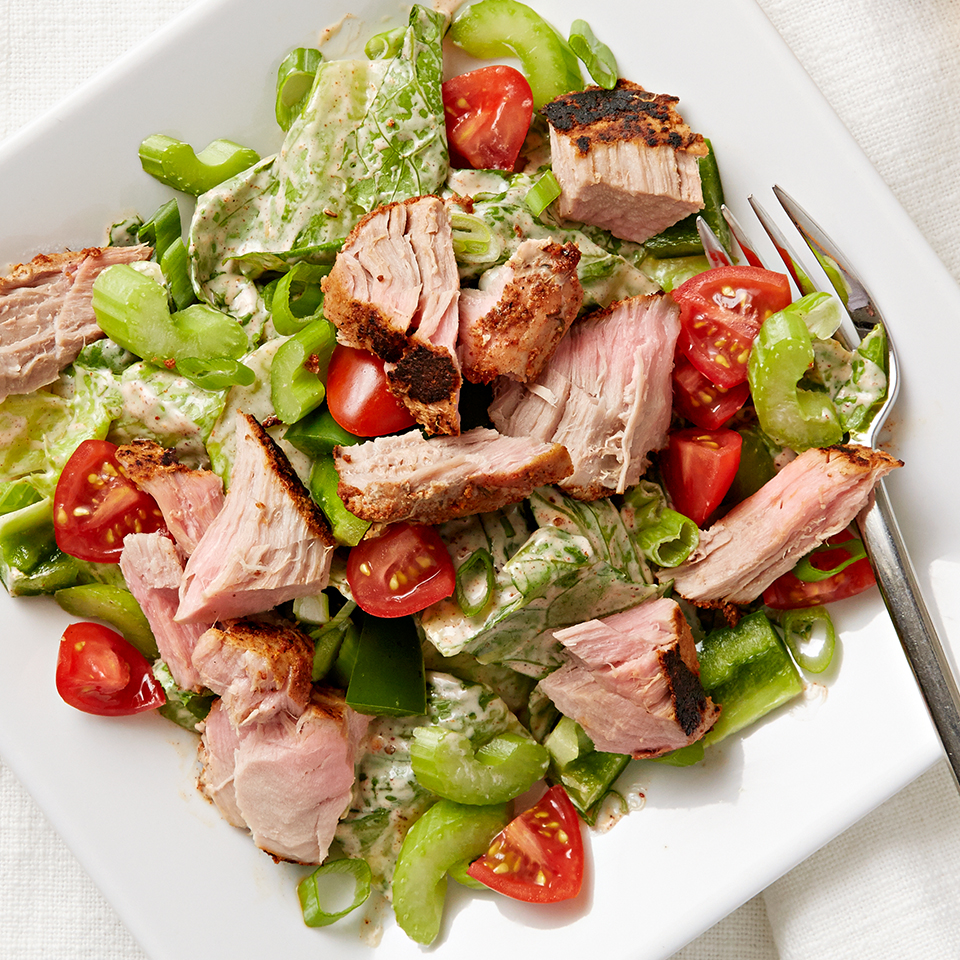 Fresh tuna tops a colorful romaine salad with tomatoes, green peppers and ranch dressing seasoned with Cajun spices. Source: Diabetic Living Magazine