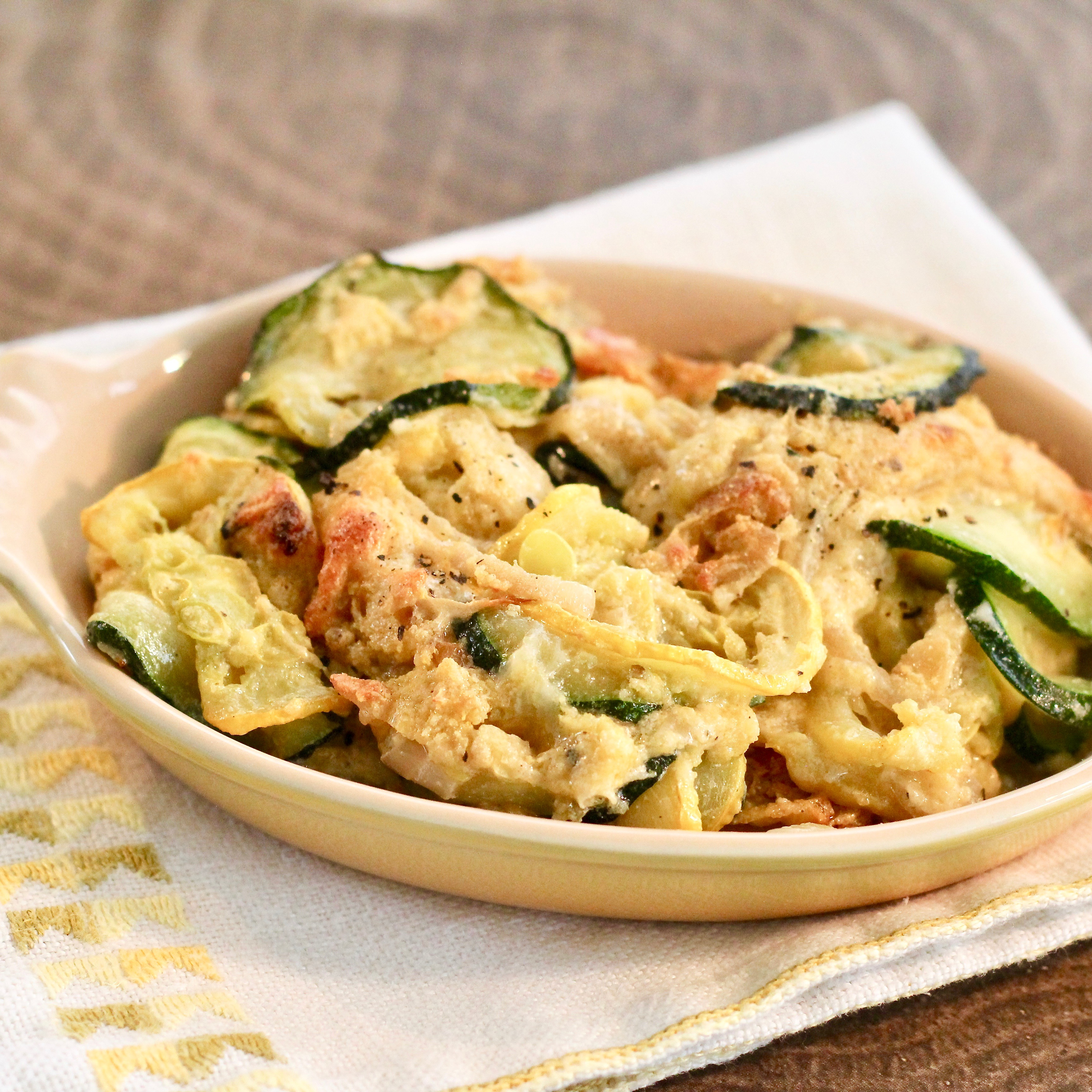 Buttery cracker crumbs and Mexican cheese blend make the irresistible topping for this gratin. If you prefer the zucchini more al dente, reviewer daphneryan suggests cutting down on the saute time before the zucchini goes into the baking pan.