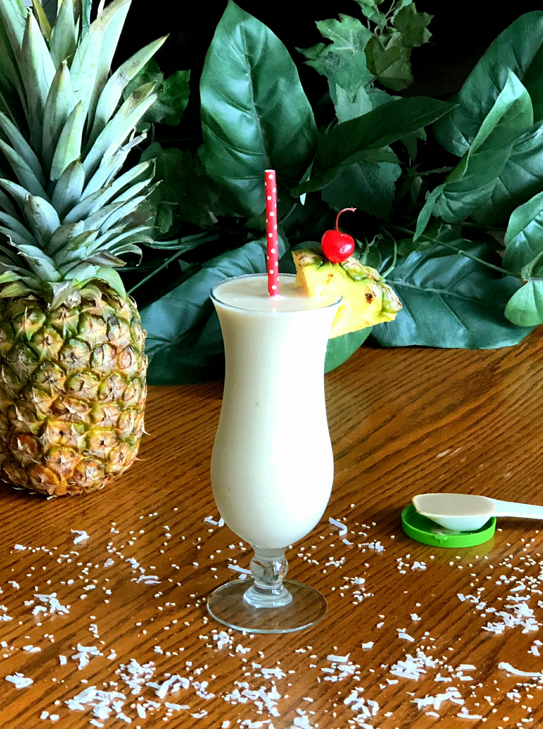 "This blended shake of shredded coconut, fresh pineapple, coconut milk, and a little tahini ""will make your taste buds think you are sitting on a Caribbean beach sipping the day away,"" says Yoly."