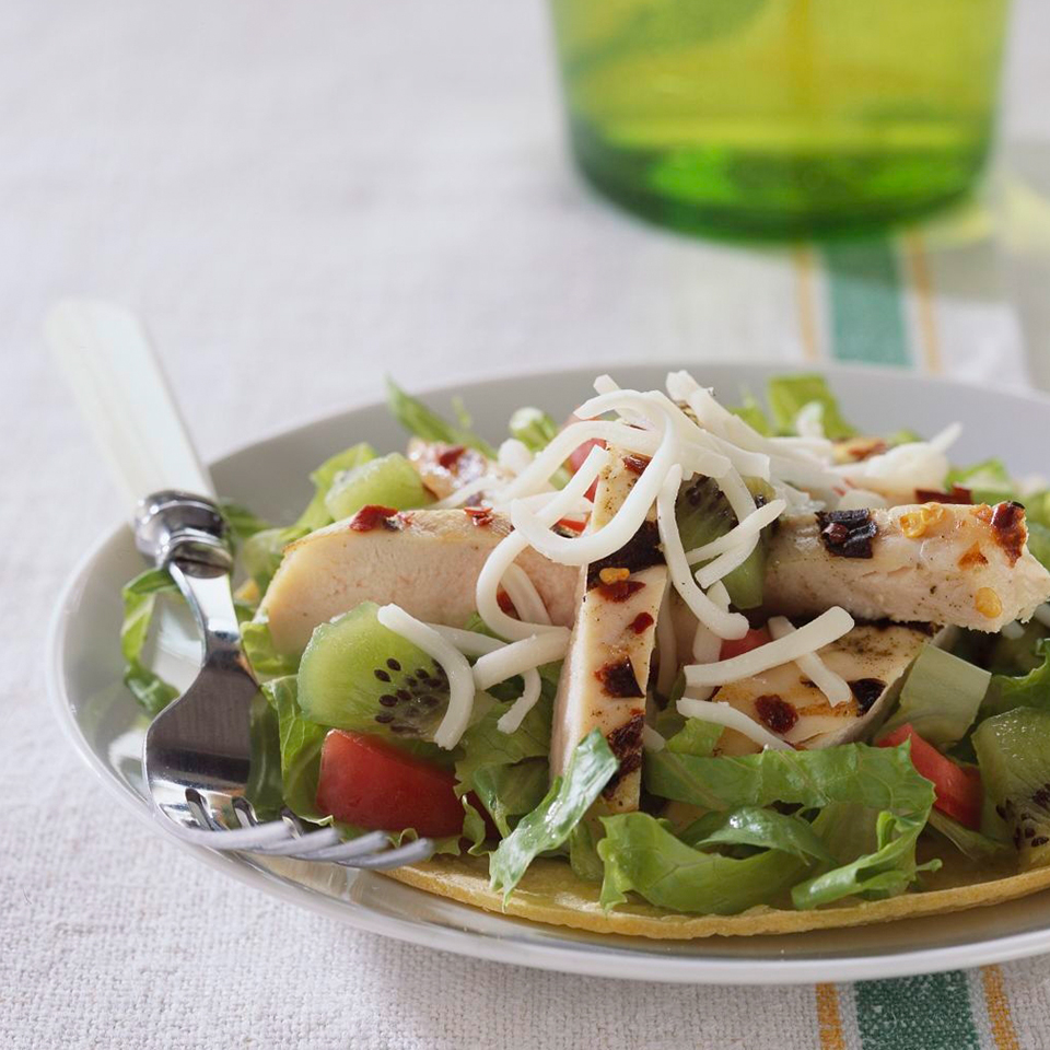Cumin and red pepper spice up the grilled chicken in this fun tostada recipe. Kids will love the sweet kiwi topping.