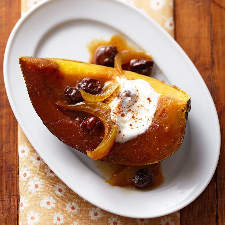 Acorn squash is a delicious savory side dish but it can also be served as a sweet treat. In this slow-cooker recipe, the nutty flavor of the squash is enhanced by tart cherries, sweet onion and vanilla extract. Topped with low-fat yogurt and cinnamon, it's a dish your guests will love.