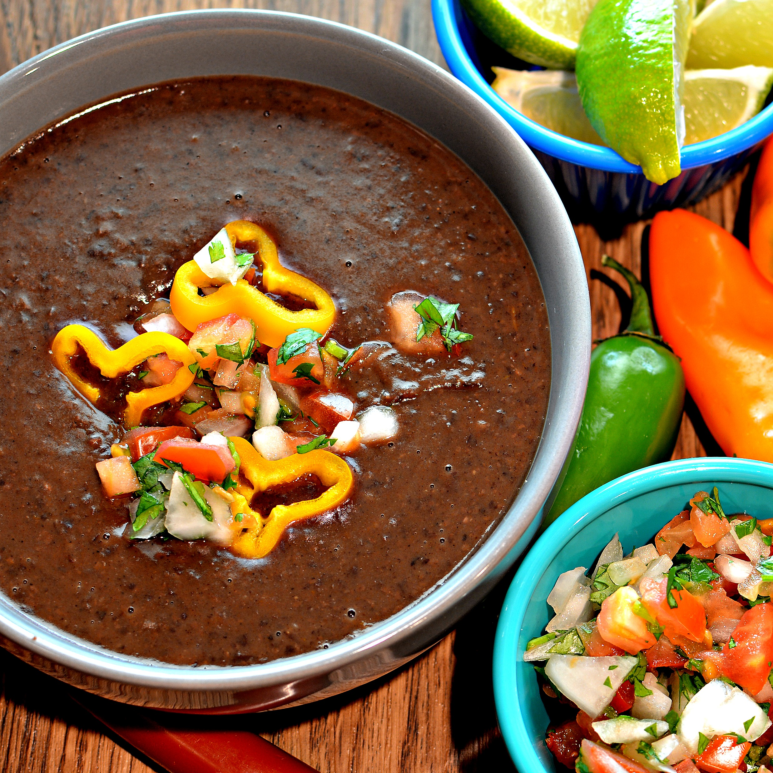 "Dry black beans, garlic, yellow bell peppers, and Hatch chile peppers hit the Instant Pot with vegetable broth and seasonings. ""This recipe works perfectly,"" says Buckwheat Queen. ""It's chock full of flavor."""