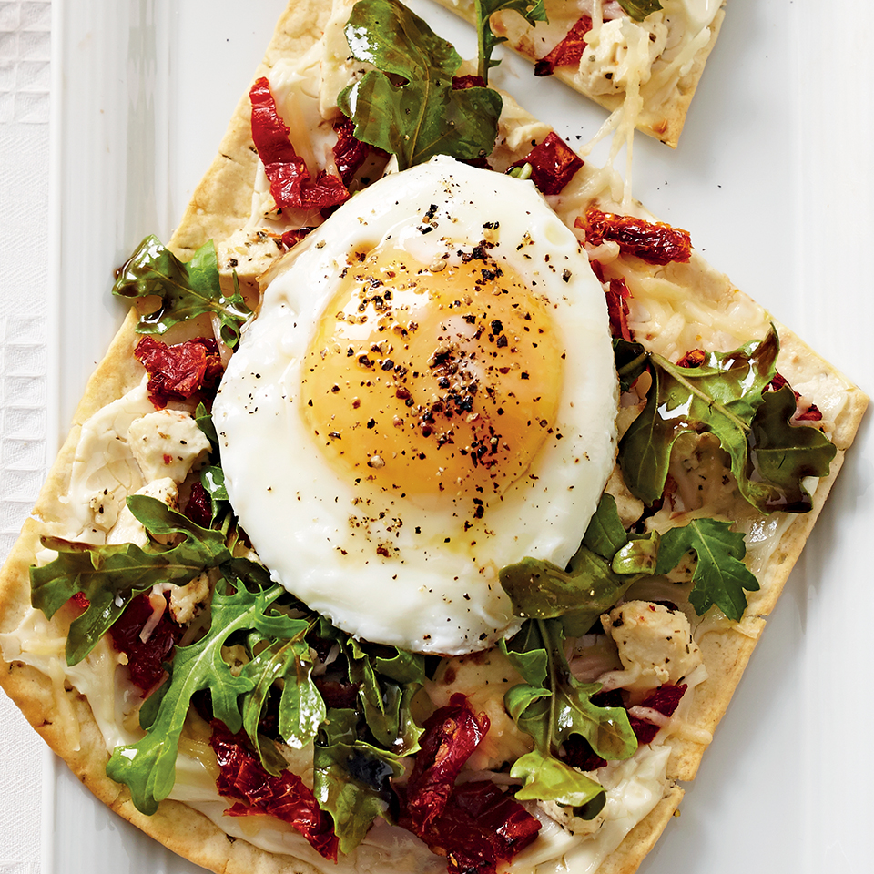 Sun-dried tomatoes, arugula and three kinds of cheese are a delightful combination in this quick-and-easy, 15-minute pizza recipe. You'll love the fried egg on top! Source: Diabetic Living Magazine