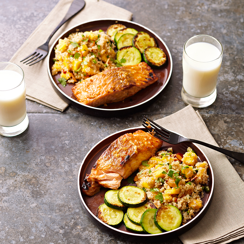 In this 30-minute dinner recipe, grilled, honey mustard-coated salmon is served with a tasty grain salad made with quinoa, mango, jalapeño and almonds.