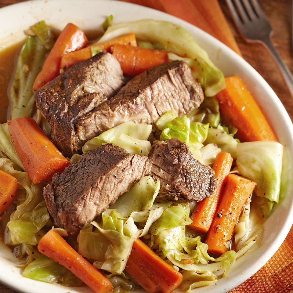 In this main-dish recipe, the pot roast is slow-cooked with carrots and low-sodium beef broth. Toward the end of the cooking time, shredded cabbage is added in to round out the meal. Each of the two servings has just 215 calories.