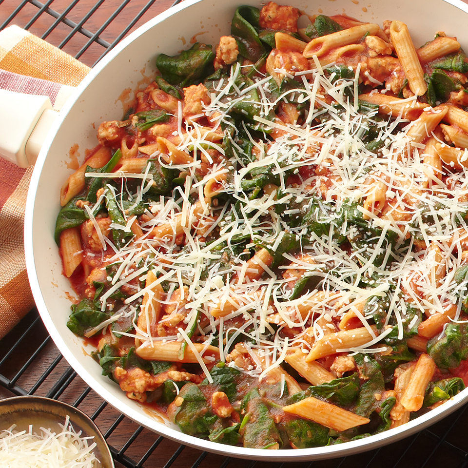 This delicious one-skillet pasta meal-for-two is ready in just 35 minutes! Turkey--seasoned with a spicy Italian-seasoning blend--is served with tomoto sauce and wilted spinach over multi-grain pasta.